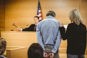 Judge banging his gavel over decision on the criminal case.